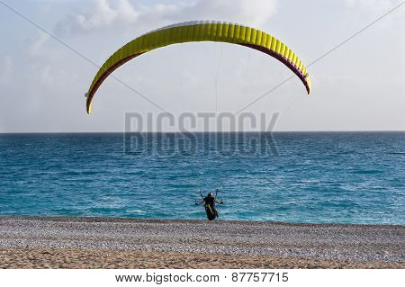 Paraglider Landing On A Beach.