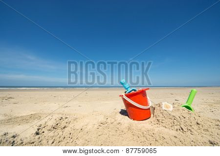 Summer beach with toys and flip flops