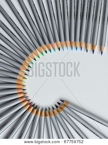 Colorful Pencils Arranged In A Wave Isolated Over White  Background