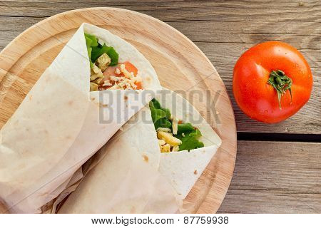 Chicken Fajitas On Wooden Plate Top View