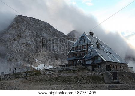 TRIGLAV, SLOVENIA - SEPTEMBER 1, 2011: Triglavski Dom na Kredarici mountain hut (2,515 m) at the foot of Mount Triglav (2,864 m) in the Julian Alps, Slovenia.
