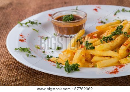French fries on a plate with different spices