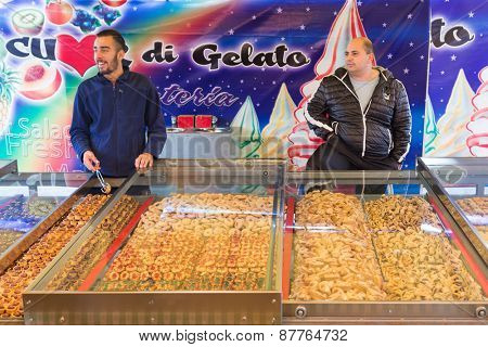 MARSAXLOKK, MALTA - JANUARY 11, 2015: biscuit and cookie salesmen at Marsaxlokk market, one of the city's main features especially on Sunday.