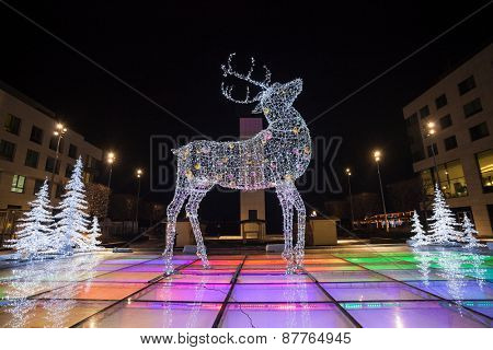 BRATISLAVA, SLOVAKIA - JANUARY 6, 2015: Decorative reindeer made of Christmas light in front of Galleria Eurovea shopping centre at night.