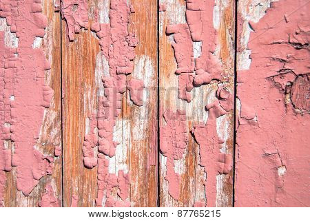 chipped paint on the wall of the old boards