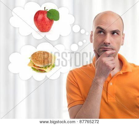 Man Choosing Between Apple And Sandwich