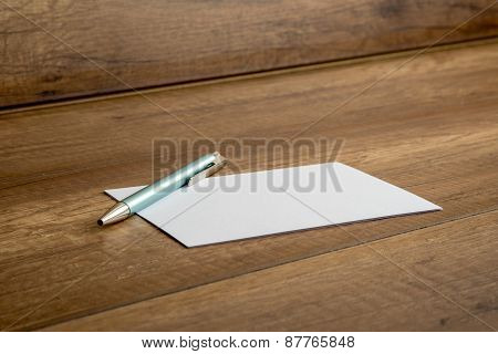 Ballpoint Pen And Blank Card On A Table