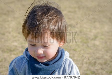Cute Boy In Playground