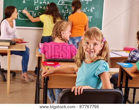 School child with teacher in classroom. Group people.