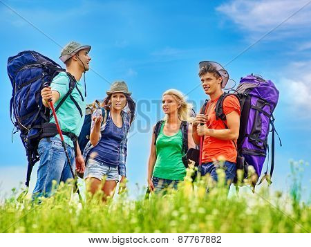 Group people with backpack  summer outdoor. Camping.