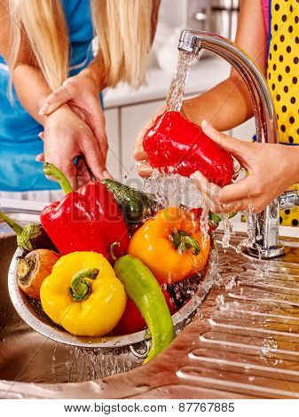 Hand body part  woman washing fruit at kitchen.