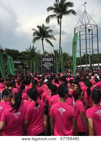 SINGAPORE APRIL 11: Participants of the AIA Sponsored Music Run arriving at Sentosa take part in the 5km fun run, Sentosa island Apr 11, 2015, Singapore