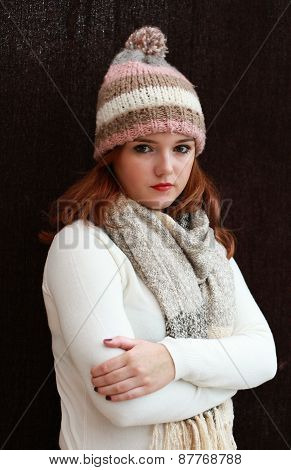 Pretty Red Headed Girl Wearing Pom Pom Hat And Scarf