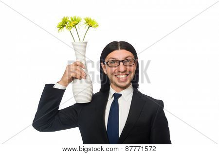 Handsome businessman holding vase of flowers isolated on white