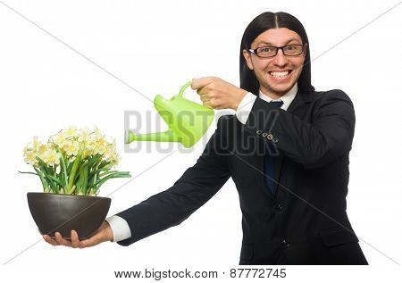 Handsome businessman holding spring flowers isolated on white