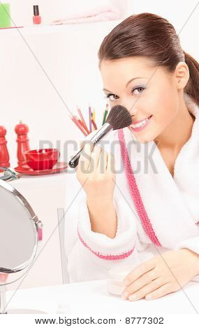 Lovely Woman With Brush And Mirror