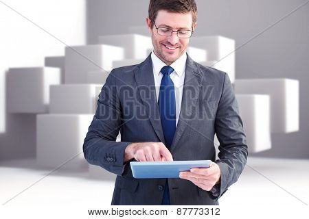 Businessman using his tablet pc against abstract background