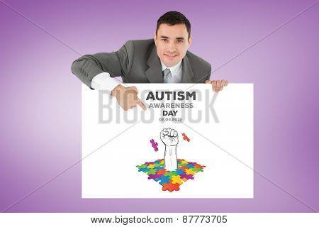 Businessman pointing at sign under him against purple vignette