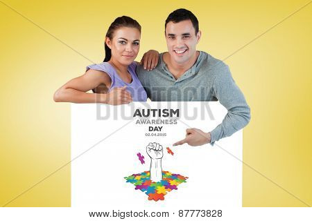 Young couple presenting advertisement against yellow vignette