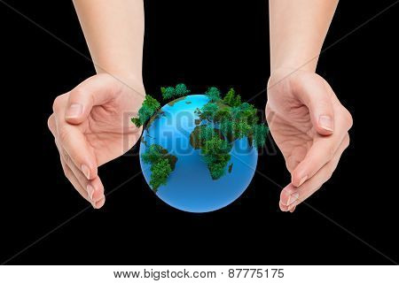 Hands presenting against earth with forest