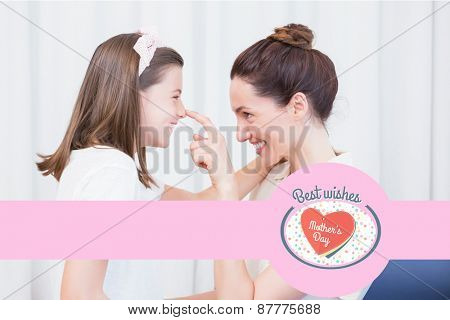 mothers day greeting against mother and daughter smiling at each other