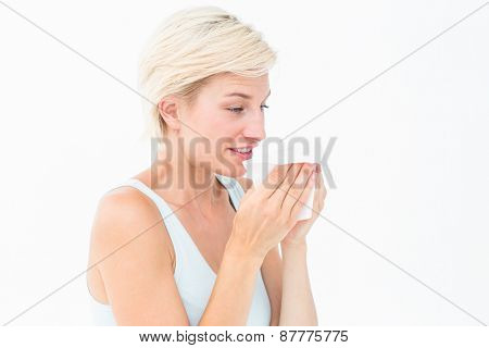 Sick blonde sneezing on white background