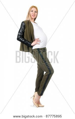 Pregnant woman in fashionable costume isolated on white