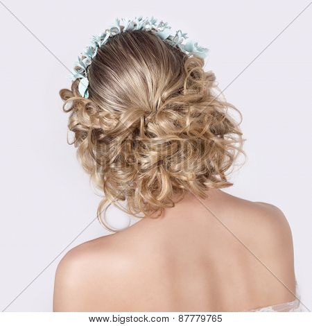 beautiful young sexy elegant sweet girl in the image of a bride with hair and flowers in her hair