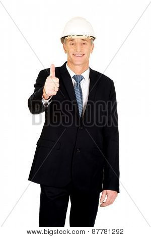 Mature engineer businessman showing ok sign.