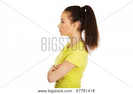 Young student woman with folded arms.
