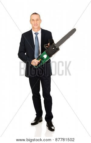 Happy mature businessman with chainsaw.