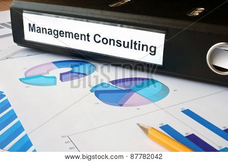 Graphs and file folder with label Management Consulting.