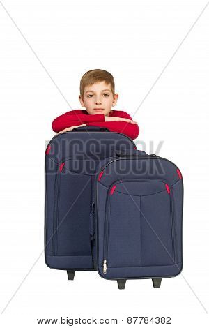Portrait Of Smiling Boy With Travel Bags Isolated On White
