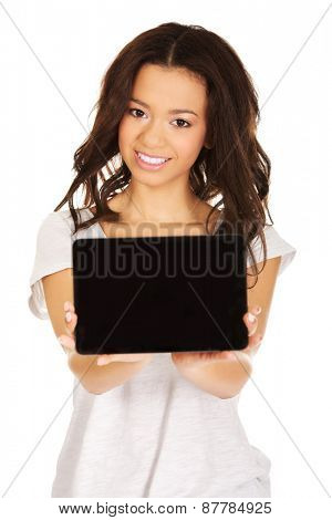 African woman showing tablet computer.