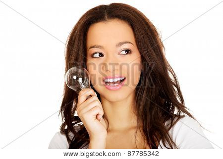 African young woman with light bulb.