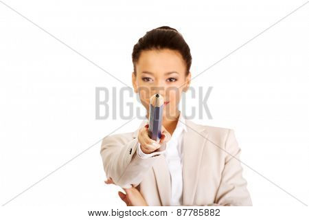African businesswoman pointing on you with big pencil.