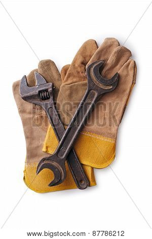 Two Wrenches On Protective Gloves On A White Background