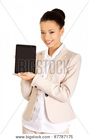 Beautiful african business woman showing the tablet.