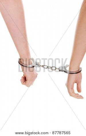 Young beautiful caucasian couple handcuffed.