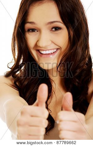 Young student woman showing thumbs up.