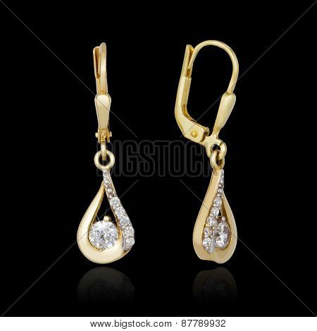 Gold Earrings Isolated On The Black Background