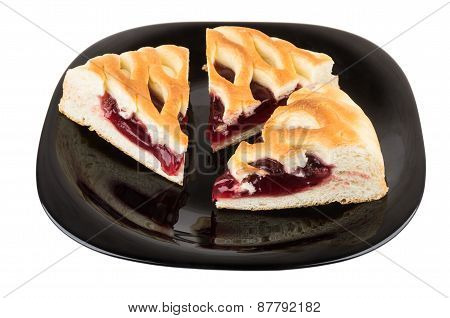 Three Pieces Of Cherry Pie In Black Glass Plate On White
