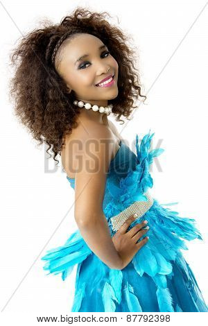 African Female Model Wearing Turquoise Feathered Dress, Big Afro, Sideways