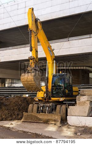 Moscow, Russia April 11, 2015: Modern Jcb Excavator Machinery Performs Excavation Work Near The Cons