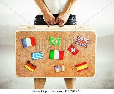 Man Holding Travel Bag