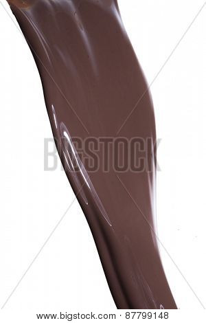 pouring chocolate syrup, isolated on white background