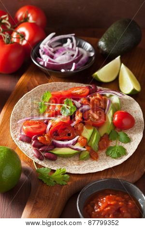 vegan taco with vegetable, kidney beans and salsa