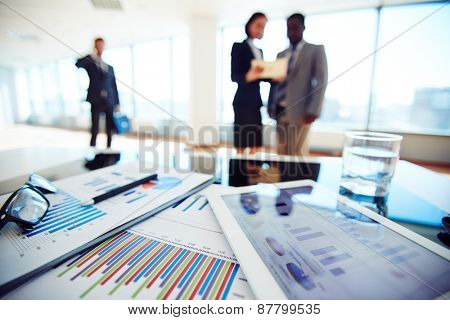 Paper and electronic business documents on desk