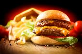 picture of hamburger  - Hamburger with fries on wooden table - JPG