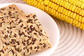 stock photo of sweet-corn  - sweet cake on white plate and corn - JPG